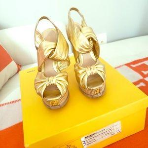 Gold leather fendi heels
